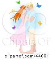 Clipart Illustration Of A Blond Man Adoring A Red Haired Woman Surrounded By Butterflies