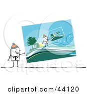 Clipart Illustration Of A Stick Man Wearing A Cap And Holding A Picture Of Him Holding A Picture In A Winter Landscape