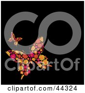 Royalty Free RF Clip Art Of Floral Butterfly Designs Against A Black Background