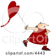Valentines Day Man Flying A Heart Shaped Kite Clipart