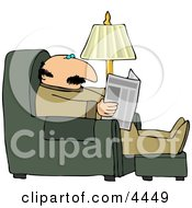 Man Sitting On A Recliner In His Livingroom Reading The Local Newspaper
