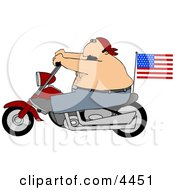 American Male Patriot Riding A Motorcycle With An American Flag