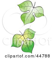 Royalty Free RF Clipart Illustration Of Two Falling Green Tree Leaves by Lal Perera