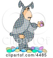 Man Wearing An Easter Costume And Holding A Decorated Easter Egg Clipart