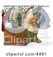 Dry Cleaner Standing Beside Clothing And Cash Register