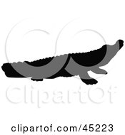 Royalty Free RF Clipart Illustration Of A Profiled Black Crocodile Silhouette by JR