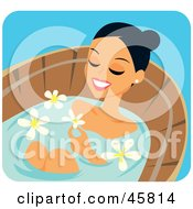 Relaxed Woman Soaking In A Bath Treatment With Flowers