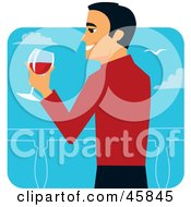 Hispanic Man In A Red Sweater Drinking Red Wine