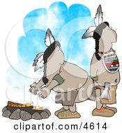 Two Native American Indians Standing Alertly Beside A Campfire Clipart
