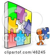 Royalty Free RF Clipart Illustration Of An Orange Smartoon Character Completing A Jigzaw Puzzle by Tonis Pan