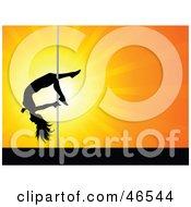 Talented Female Pole Dancer Sliding Down The Pole On Her Leg