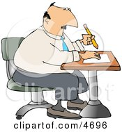 Businessman Sitting At A Desk And Writing On Paper With Pencil