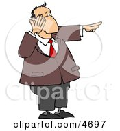 Businessman Laughing While Pointing His Finger At Something Clipart