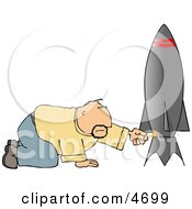 Man Lighting The Fuse On His Model Rocket