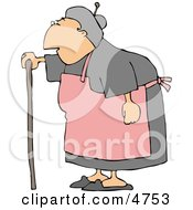 Female Senior Citizen Wearing An Apron And Using A Walking Stick