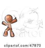 Brown Design Mascot Man Writing Tribal Designs On A Wall