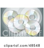 Royalty Free RF Clipart Illustration Of Reflective CDs On Gray by Prawny
