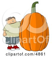 Smiling Boy Standing Beside A Giant Halloween Pumpkin