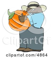 Ethnic Male Farmer Carrying A Pumpkin For Halloween