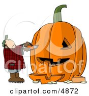 Man Carving A Face Into Big Pumpkin For Halloween Clipart