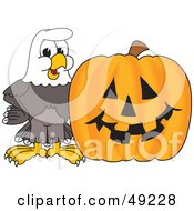 Royalty Free RF Clipart Illustration Of A Bald Eagle Character With A Pumpkin by Toons4Biz