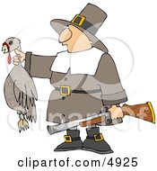 Successful Male Pilgrim Hunter Holding A Dead Turkey And A Gun - Thanksgiving Holiday