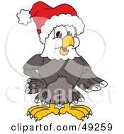 Royalty Free RF Clipart Illustration Of A Bald Eagle Character Wearing A Santa Hat by Toons4Biz