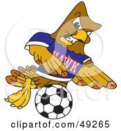 Hawk Mascot Character Kicking A Soccer Ball