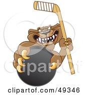 Cougar Mascot Character Grasping A Hockey Puck
