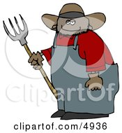 Smiling Mexican Cowboy Farmer Holding A Pitchfork Clipart by djart