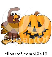 Royalty Free RF Clipart Illustration Of A Falcon Mascot Character With A Pumpkin