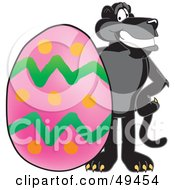 Royalty Free RF Clipart Illustration Of A Black Jaguar Mascot Character With An Easter Egg by Toons4Biz