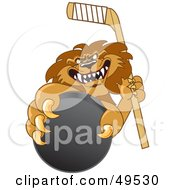 Lion Character Mascot Grabbing A Hockey Puck