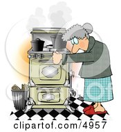 Elderly Woman Cooking Food On An Old Household Kitchen Stove