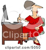 Woman Wearing A Red Dress While Working At A Computer Desk