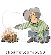 Cowboy Man Roasting A Marshmallow Over A Campfire Clipart