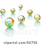 Scattered Rainbow Colored Marbles With Reflections