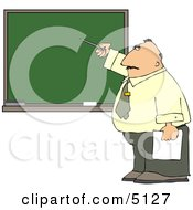 Male School Teacher Pointing At A Blank Chalkboard