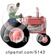 Male Ethnic Farmer Waving Hello On A Tractor