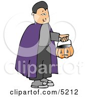 Boy Wearing Halloween Vampire Costume And Trick-Or-Treating With A Pumpkin Candy Bucket