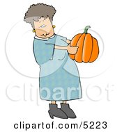 Woman Carrying An Uncarved Halloween Pumpkin Clipart