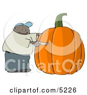 African American Man Carving A Face Into A Big Halloween Pumpkin Clipart
