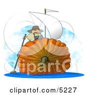 Humorous Man Sailing On An Oversized Pumpkin Sailboat