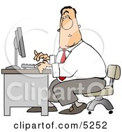 Man Typing On A Computer Keyboard In His Office At Work Clipart
