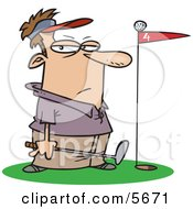 Male Golfer Standing By A Golf Ball On Top Of A Red Flag