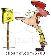 Woman Reading A Sign That Says Beware Of Sign
