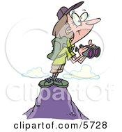 Woman Hiker On Top Of A Mountain Holding Binoculars