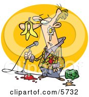 Middle Aged Stand Up Comedian Man With Food Being Thrown At Him Clipart Illustration by Ron Leishman