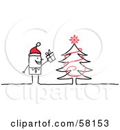 Stick People Character Man Wearing A Santa Hat And Standing By A Christmas Tree