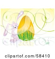 Cute Pink Easter Bunny Peeking Around A Golden Egg In Grass